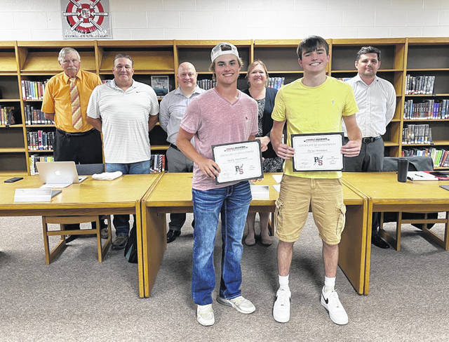 The Preble Shawnee Board of Education recognized the following students at its June 29 meeting: Brooke Dalton, FFA State; Degree; Madison Barnett, FFA Gold Rated Treasurer's Book; Hailey Wells, FFA Gold Rated Reporter's Book; Megan Roell, FFA 1st Place Ohio Ag Communications Proficiency Award; Carter Roell, FFA American Degree; Jared Dunn, State FFA Officer for the 2021-22 school year; Dylan Hatmaker, SWBL Player of the Year/First Team Baseball; Grady Hutchinson, SWBL First Team Baseball and Katie Craft, SWBL First Team Softball. Hutchinson (front left) and Hatmaker (front right) were in attendance.