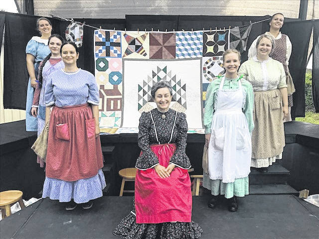 The cast, from left to right, includes: Sarah Burket, Emma Socey, Shanna Camacho, Margie Stoller, Anna Wible, Liisa Kilmer, and Gypsy Rose.