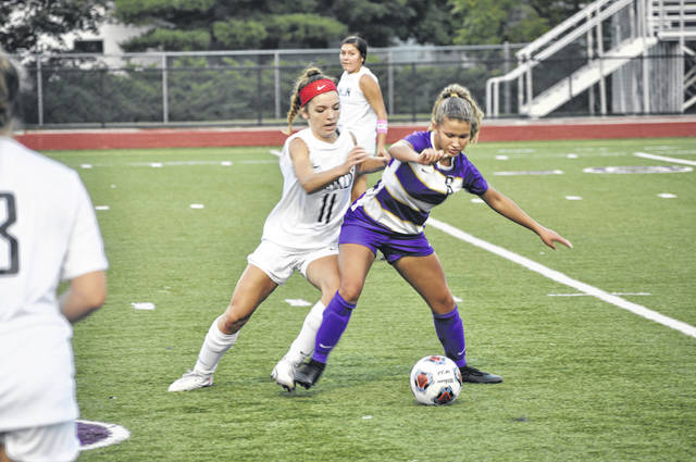 Eaton then-junior Amyah Thacker fights for the ball during Eaton's game against Franklin on Thursday, Sept. 10, 2020.