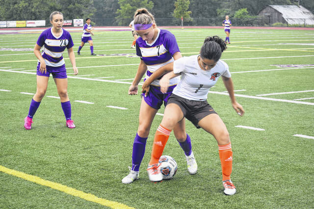 Eaton senior Rylee Ruebush and National Trail senior Paige Lee fight for the ball near the sideline during their game on Thursday, Aug. 31. Eaton won 5-1.