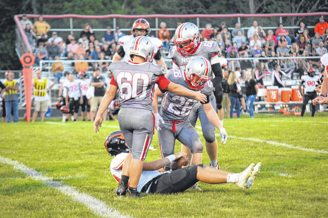 Tri-County North sophomore Colten Vanwinkle celebrates after a tackle during North's game against Arcanum on Friday, Sept. 17. North lost 48-16.