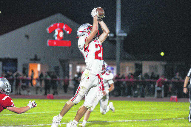 Tri-County North sophomore Alex Klingenberger hauls in a catch during their game against Dixie on Friday, Sept. 10. North won 40-27.