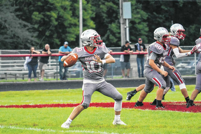 Tri-County North sophomore quarterback Logan Flory winds up a pass during Friday's game against Bradford. North won 36-14.