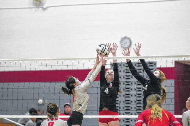 Preble Shawnee sophomores Delaney Klapper (#4) and Kahlen Kulms (#24) block a kill attempt by Twin Valley South during their match on Thursday, Sept. 23. The Arrows won in three sets.
