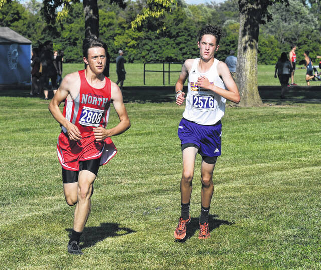 Eaton's Charles Kochensparger (right) and Tri-County North's Hunter Pahl compete during the Valley View Cross Country Invitational on Wednesday, Sept. 8. Eaton won both the boys and girls team titles.