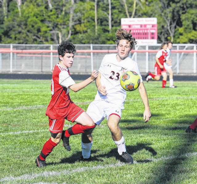 Tri-County North's Jackson Isaacs (left) battles with Preble Shawnee's Xavier Deaton for possession during a soccer game on Thursday, Sept. 2. North won 3-2
