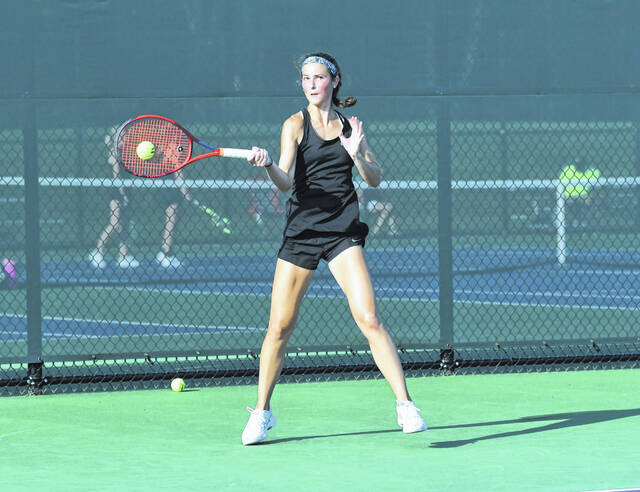 Eaton senior Grace Murphy returns a shot during the Eagles match with Indian Hill on Tuesday, Sept. 28. Eaton knocked off IH 3-2 to advance in the state team tournament.