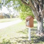 Bidwell family promotes reading with front-yard library