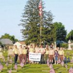 Scouts plant flags for vets