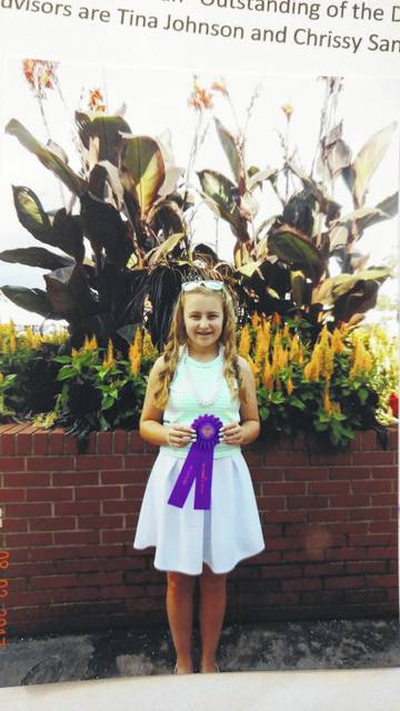 "Olivia Harrison, a member of Early Birds 4-H Club, competed at the Ohio State Fair with her clothing project ""Look Great for Less."" After participating in judging and a fashion review, she received an ""Outstanding of the Day"" rosette. Her advisors are Tina Johnson and Chrissy Sanders."