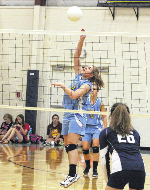 Ohio Valley Christian senior Cori Hutchison hits a spike attempt during Game 1 of Thursday night's non-conference volleyball contest against Hannan in Gallipolis, Ohio.