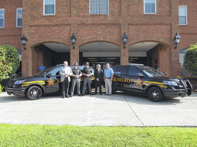 Pictured left to right are Gallia Commission President Harold Montgomery, Sheriff Deputy Kyle Perez, Sheriff Matt Champlin, Commission Vice-President David Smith and Commissioner Brent Saunders.