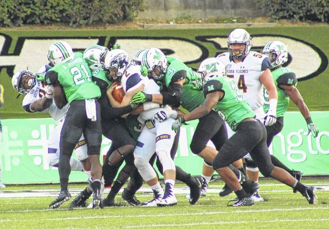 Marshall defenders Brandon Drayton (8), Ryan Bee (91) and Frankie Hernandez (35) combine to take down Kent State quarterback George Bollas (2) during the first half of Saturday night's non-conference football contest at Joan C. Edwards Stadium in Huntington, W.Va.