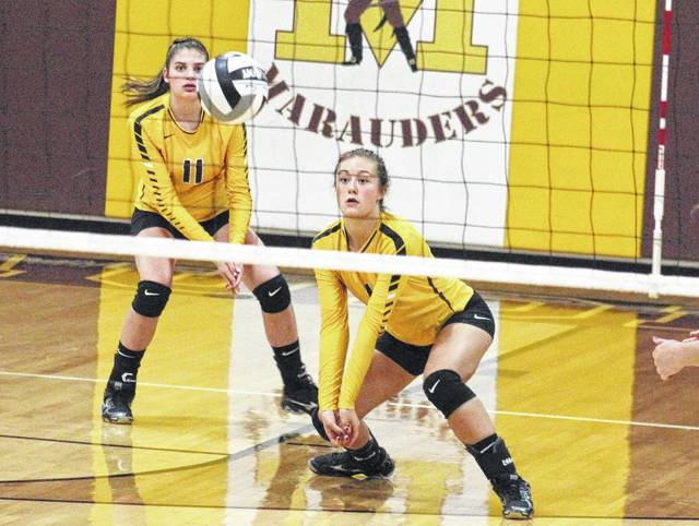 Meigs freshman Baylee Tracy (1) defends an attack in front of classmate Hannah Durst (11), during the Lady Marauders' loss to Athens on Tuesday in Rocksprings, Ohio.