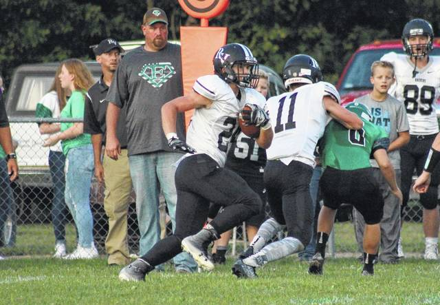 River Valley sophomore Cole Young (24) runs behind a block from Brandon Call (11) during the Raiders' Week 1 victory over Eastern in Tuppers Plains, Ohio.