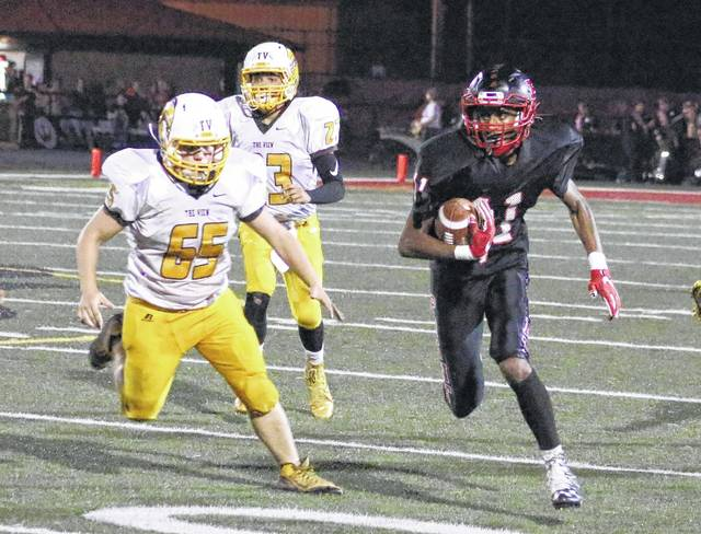 Point Pleasant sophomore Jovone Johnson, right, returns an interception during the second quarter of Friday night's Week 5 football game against Mount View at OVB Field in Point Pleasant, W.Va.