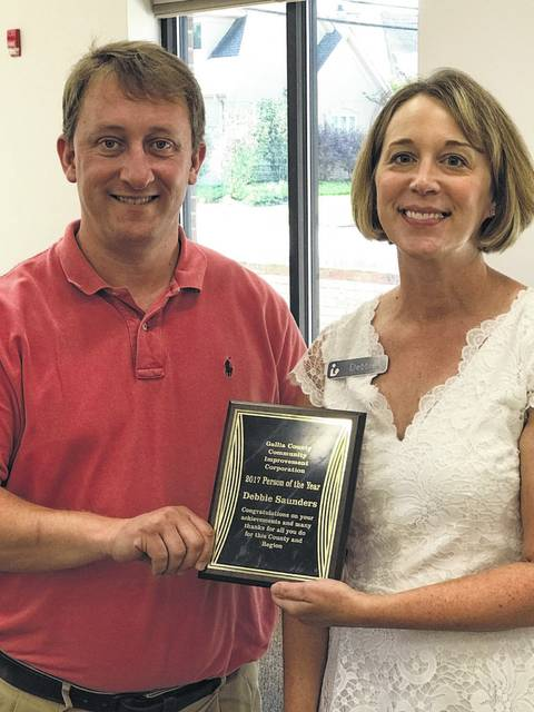 CIC President Josh Bodimer (left) presents Bossard Memorial Library Executive Director Debbie Saunders (right) with a Person of the Year award from the CIC.