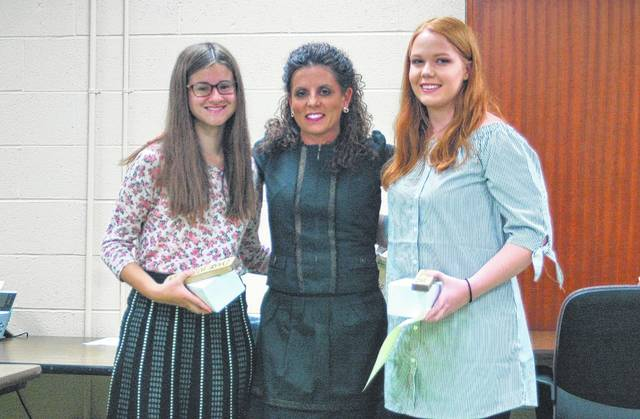 From left, Sharla Moody, Brea McClung, and Alyssa Bennett at the Gallia Local School Board Meeting last Thursday.