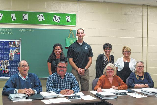 Members of the Gallia County School Board seated with teachers who are a part of the Diamonds in the Rough project. From left, front row: Melvin Carter, Terry Halley, Beth James, and Stephanie Mulford. From left, back row: Brea McClung, Aaron Walker, Stephanie Campbell, and Cindy Graham.