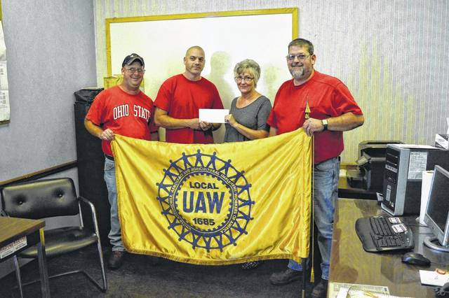United Automotive, Aerospace and Agricultural Implement Workers of America (Local UAW 1685) provide a donation of $500 to the Friends of Gallia County's Animals, a local animal rescue initiative. From left to right stand UAW member Mike Miller, UAW member Keith Mabe, Friends of Gallia County's Animals President Paula Saunders, and UAW member Rick Rardin. Saunders thanked Bob Evans Farm for its support in the past and those who have fostered animals with the group. The group started in 2010 with the purpose of helping Gallia animals get homes. In 2016, Saunders claims the group sent around 1000 dogs and 300 cats to rescues. The group is currently looking for a more stable operating base as it is in the midst of a transition and is looking for foster families among other support. Saunders encouraged the public to reach out to the group on its Facebook page.