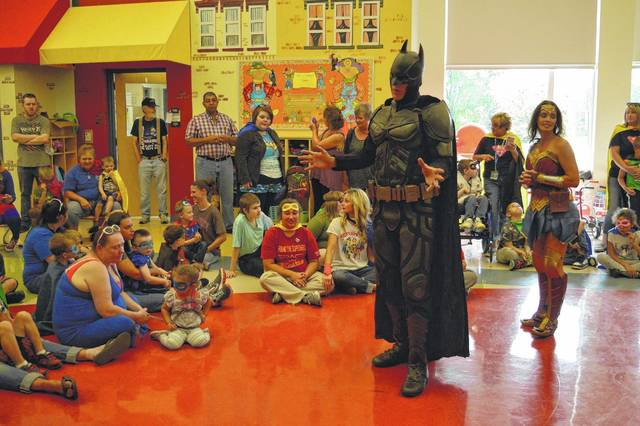Heroes-4-Higher Batman and Wonder Woman visit Guiding Hand School students and share message of inclusion, respect and doing the right thing.