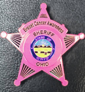 "Gallia County Sheriff Matt Champlin has announced that deputies with the Gallia County Sheriff's Office will be showing support for Breast Cancer Awareness during the month of October. Champlin said, ""Our deputies were provided with an opportunity to purchase a pink uniform badge and make a donation which will in turn be given to the American Cancer Society. For this donation, deputies will be approved to wear the pink uniform badge for the month of October. I believe it is important that we show our support to the survivors and people currently suffering from breast cancer. By doing this, not only can we show our support, but we can make a donation in hopes of helping someone in need."""