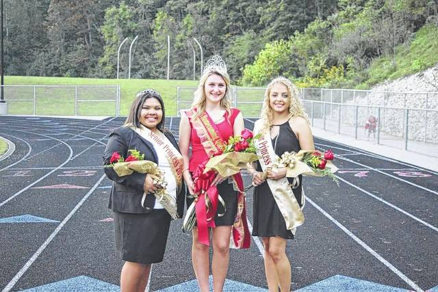 From left: Senior Attendant Kiersten Howell, Homecoming Queen Alexandria Sweeney, and Senior Attendant Aaliyah Howell.