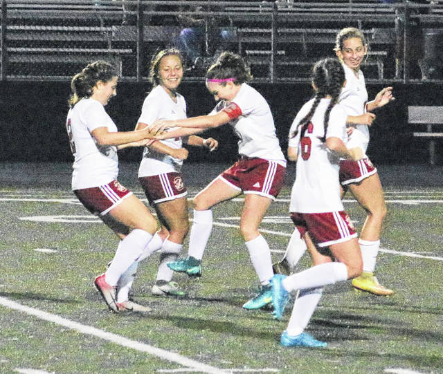 Point Pleasant sophomore Ashley Staats, left, celebrates with teammate Lexi Watkins-Lovejoy after scoring a goal during the second half of Monday night's girls soccer match against Lincoln County in Point Pleasant, W.Va.