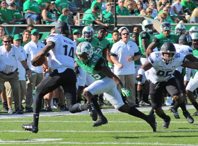 Marshall safety Malik Gant chases down ODU quarterback Steven Williams (14) during the second quarter of Saturday's Conference USA football game at Joan C. Edwards Stadium in Huntington, W.Va. (Bryan Walters|OVP Sports)