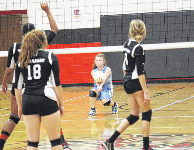 Ohio Valley Christian School's Marcie Kessinger returns a serve during the Lady Defenders' volleyball match against Point Pleasant on Tuesday in Point Pleasant, W.Va.