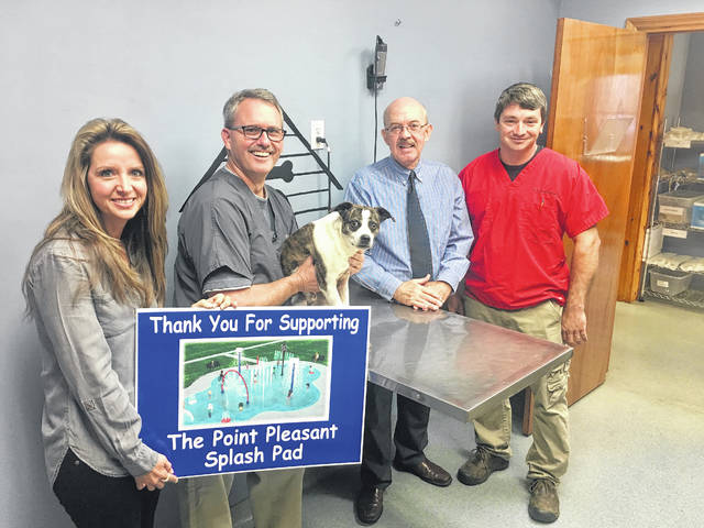Crank & Kirkpatrick Animal Hospital recently donated to the Point Pleasant Splash Pad project. Pictured, from left, City Clerk Amber Tatterson, Bill Crank, Mayor Brian Billings, Thomas Kirkpatrick and dog Brownie Veroski, owned by Joe Veroski.