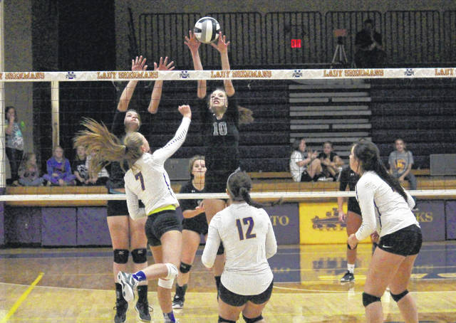 River Valley's Caterina Gattinara (10) goes up for a block along with teammate Rayanna Adkins during the Lady Raiders' Division II sectional semifinal volleyball match against Unioto on Wednesday in Chillicothe, Ohio.
