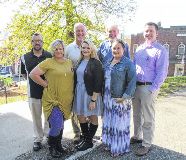 Friday was Purple Day around Meigs County as individuals wore purple in recognition of Domestic Violence Awareness Month. Pictured are (front from left) Victim Advocate Shelley Kemper, Victim Advocate Alexis Schwab, Commissioner Clerk April Burnem; (back, from left) Commissioners Randy Smith, Mike Bartrum and Tim Ihle and Prosecutor James K. Stanley.