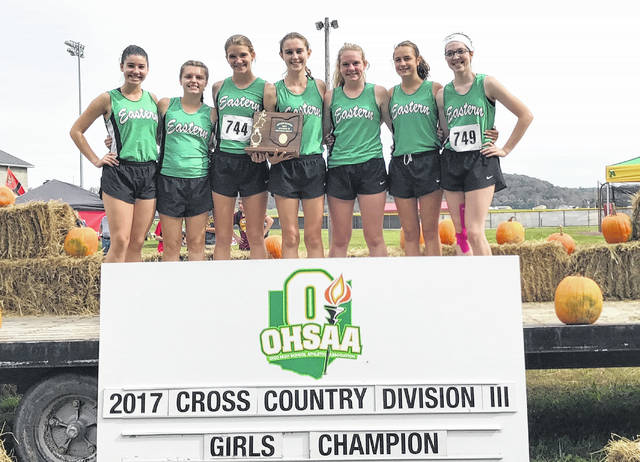 Members of the Eastern girls cross country team pose for a picture following the Division III district championship. Standing from left to right are Rhiannon Morris, Ally Durst, Jessica Cook, Kaitlyn Hawk, Whitney Durst, Lexa Hayes and Alysa Howard.