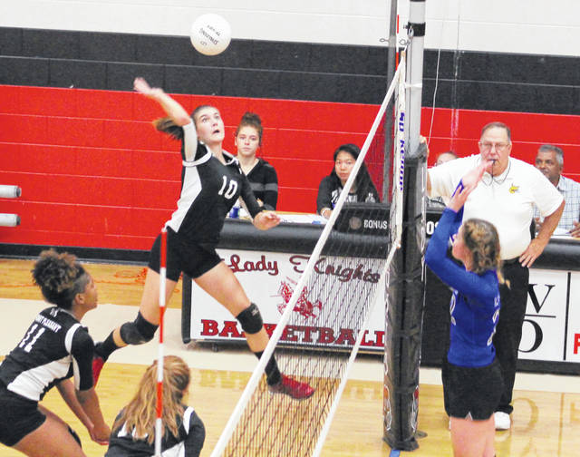 Point Pleasant sophomore Olivia Dotson (10) leaps for a spike attempt during Game 1 of Monday night's volleyball match against Teays Valley Christian in Point Pleasant, W.Va.