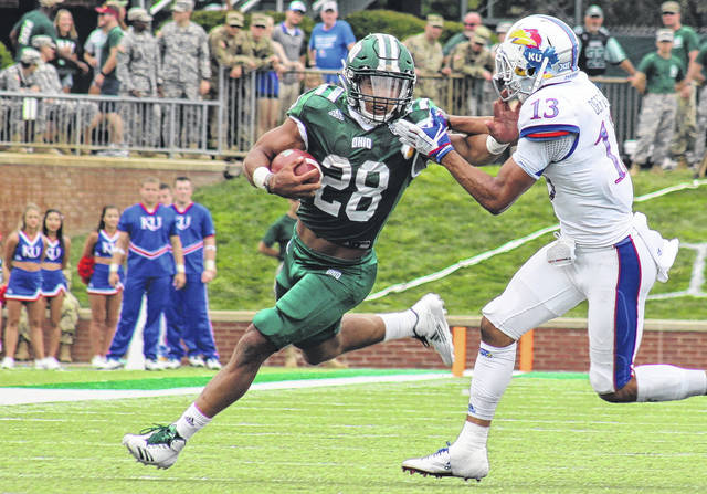 Ohio senior Dorian Brown (28) delivers a stiff-arm to Kansas' Hasan Defense (13) during the Bobcats' 12-point victory on Sept. 16 in Athens, Ohio.