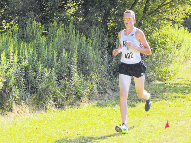 River Valley senior Nathaniel Abbott competes in the boys high school race as part of the Wellston Cross Country Invitational on Aug. 26 in Wellston, Ohio.