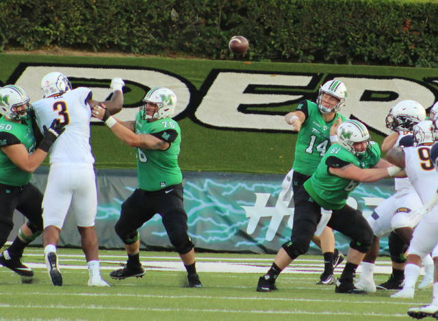 Marshall quarterback Chase Litton (14) releases a throw during the first half of a Sept. 16 football game against Kent State at Joan C. Edwards Stadium in Huntington, W.Va.