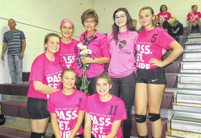 Tanya Coleman, center, is pictured with her daughter Kassandra and Meigs volleyball team members Maci Hood (6), Olivia Wyatt (5), Saelym Larsen (13), Baylee Tracy (1) and Hannah Durst (11).