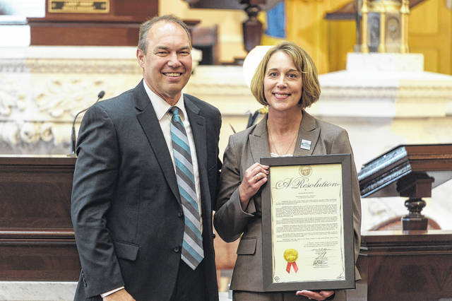 Ohio Senator Bob Peterson (R-Washington Court House) stands with Ohio Librarian of the Year Debbie Saunders of Bossard Memorial Library.