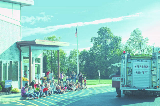 Students from Guiding Hand School learn about fire safety from volunteers of the Gallipolis Fire Department.