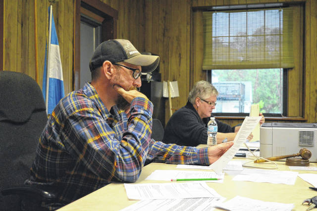 Rio Grande Mayor Matt Easter, left, discusses village concerns with the Rio Grande Village Council Monday evening. Rio Grande Fiscal Officer Jennifer Harrison runs through village finances, right.