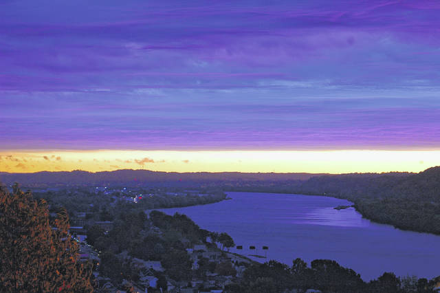 The view upriver from Mound Hill portrays the cloud cover reflecting deep colors in the morning sky Tuesday.