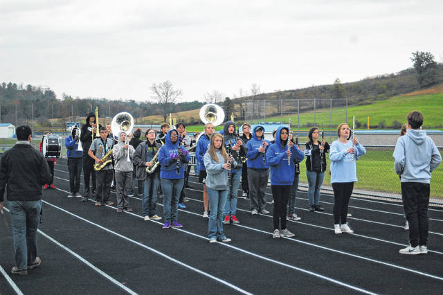 GAHS marching band warms up for practice by going through drills. They will be in Brunswick, Ohio on Nov. 4 for state competition