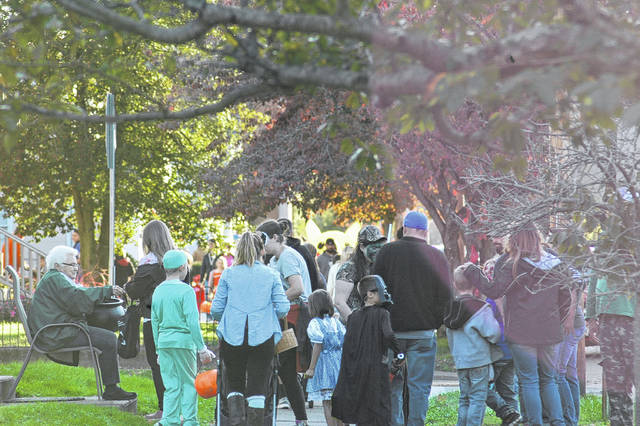 The sidewalks became hard to navigate as they filled with families and children in search of the next source of candy in Gallipolis.