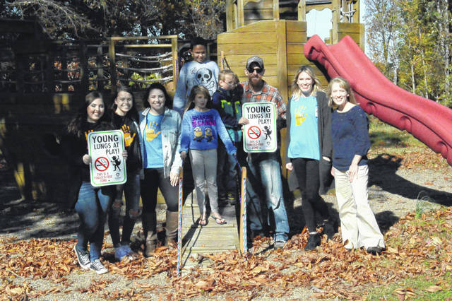 Rio Grande Elementary students, members of the Gallia Health Department, STAND and Rio Grande Mayor Matt Easter stand at the Memorial Park playground in Rio Grande.