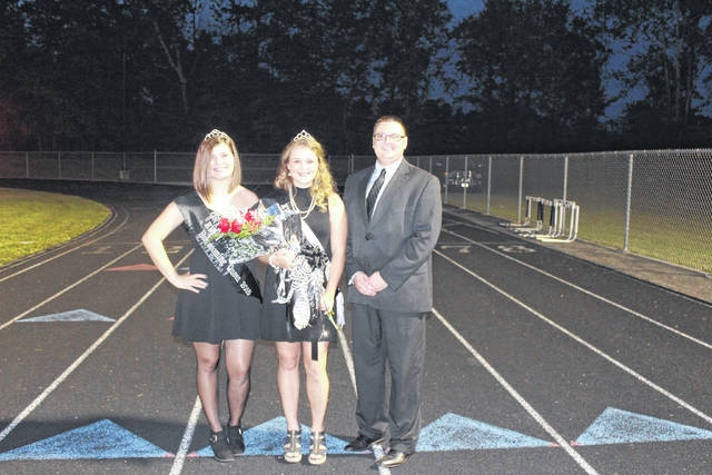 Isabella Mershon, center, was crowned on Friday night as the 2017 River Valley High School Homecoming Queen. Pictured with Mershon are 2016 River Valley High School Homecoming Queen Maggie Campbell (left) and River Valley High School Principal T.R. Edwards (right).