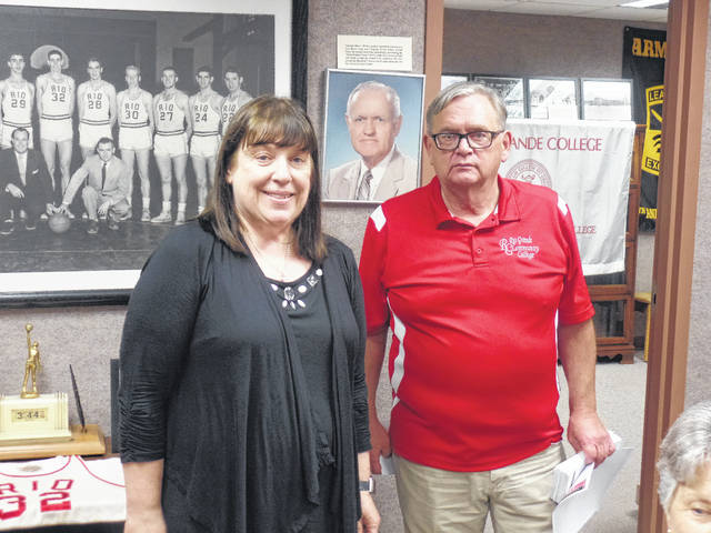 "Pictured is DKG President Lynn Arnott on the left with Jake Bapst, author of ""Here's to Old Rio"" on the right flanked in behind by pictures of Rio alumni and coach Newt Oliver and Rio's basketball team made famous by record-setter Bevo Francis."