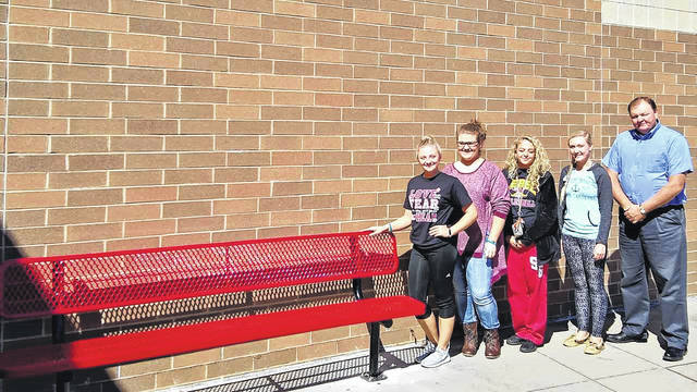 From left, Hannah Shafer, historian, Brooke Campbell, treasurer, Aaliya Howell, secretary, Riley Sanders, vice president, and Jeff Fowler, advisor. They are pictured here with the new bench purchased with funds they raised.