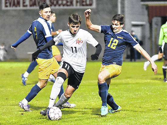 Rio Grande's Deri Corfe works his way through a pair of West Virginia University Tech defenders during Thursday night's River States Conference Men's Soccer Tournament semifinal game at Evan E. Davis Field.